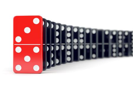 Unieke rode domino tegels en veel zwarte dominostenen. Leiderschap, individualiteit en verschil concept.