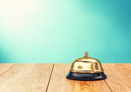 hotel reception: Brass hotel reception bell on wood desk. 3D illustration