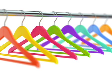 checkroom: Colorful wooden cloth hangers on clothes rail on white defocused background. 3D illustration Stock Photo