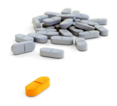 white pills: Orange and gray pills on white