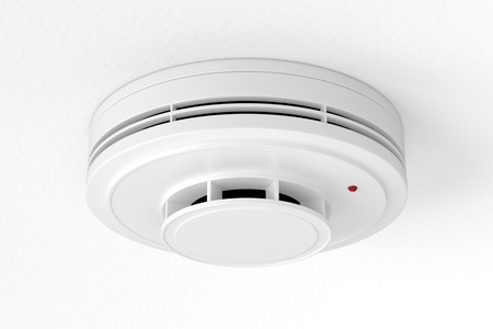 White plastic fire alarm smoke detector with red LED indicator on ceiling. 3D illustration Archivio Fotografico