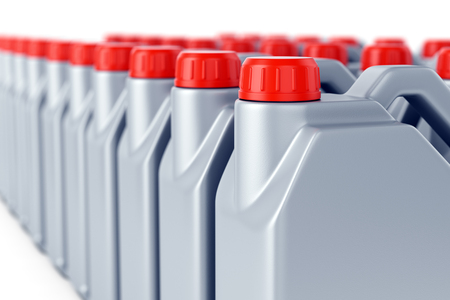 Group of motor oil grey plastic jerry cans with red lids on white background. Heavy industry, warehouse, shipping and manufacturing concept. 3D illustration Stock Photo