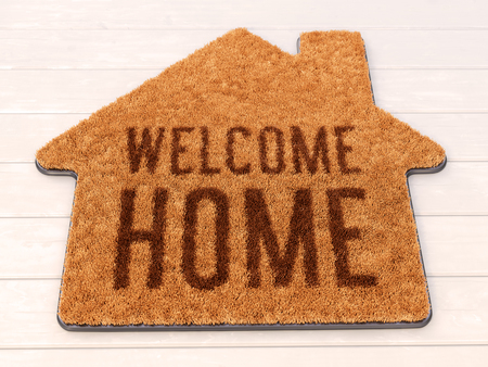 Brown house icon shape coir doormat with text print Welcome Home on wooden floor. 3D illustration Archivio Fotografico