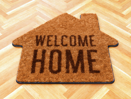 Brown house icon shape coir doormat with text print Welcome Home on wooden floor. 3D illustration Imagens