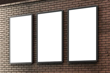 Group of blank billboard lightboxes or urban media LCD screens on brown brick wall. Empty street advertising signboards. 3D illustration, copy space