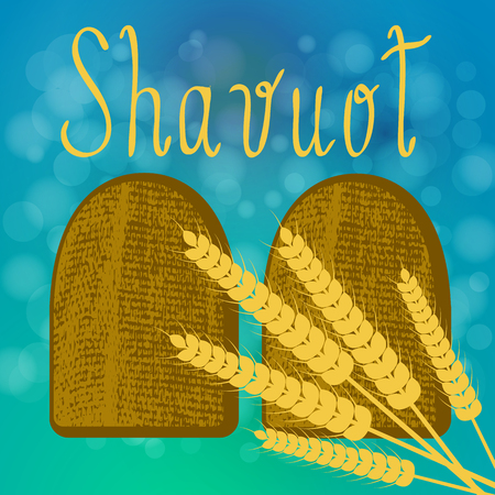 Shavuot. Concept of Judaic holiday. Tablets of the covenant of Moses Bible Torah. Ten Commandments. Ears of wheat. Blue background, blur