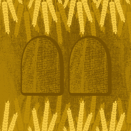 Shavuot. Concept of Judaic holiday. Ears of wheat and tablets. Brown background, burlap texture