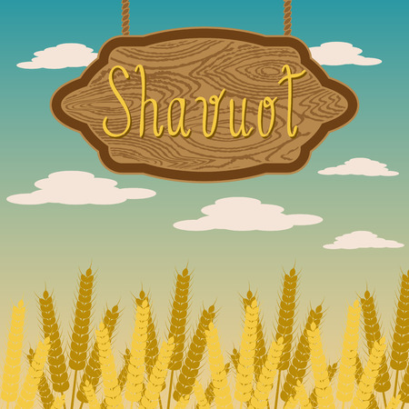 Shavuot. Name of the holiday on a wooden signboard. Ears of wheat. Background sky with clouds