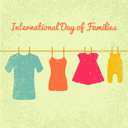 International Day of Families. Concept of a family of 4 people - father, mother, daughter, baby. Clothes dries on clothespins on a rope - men t-shirt, female T-shirt, dress, sliders. Grunge effect.