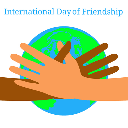 International Day of Friendship.  Concept of a peaceful holiday. Hands of people of different nationalities. They stretch out to each other, give heart. Planet Earth on the background.