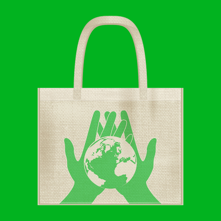 Canvas cotton textiles eco bag. Hands carefully hold the Earth. Natural color. Stop plastic pollution. Grunge burlap texture