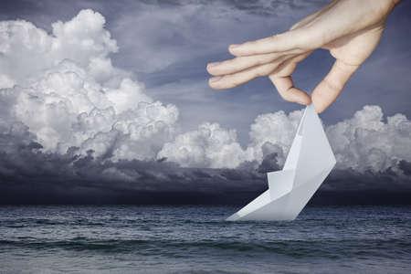 Saving a sinking paper boat photo