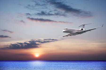 private jet: Private jet cruising at sunset
