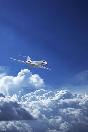 Private jet plane in a blue sky Stock Photo