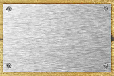 bolted: Blank steel plate bolted to a wooden surface