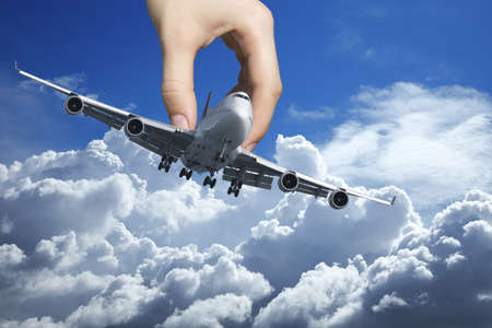 act of god: Hand playing with a real jet aircraft Stock Photo