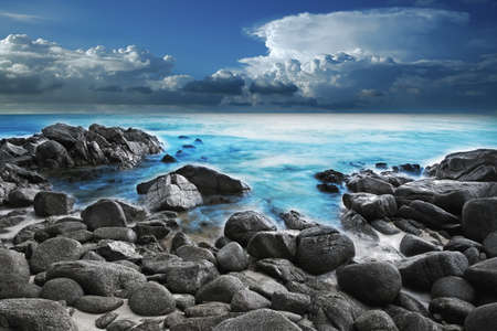 beach scene: View of a rocky coast in the morning. Long exposure shot.