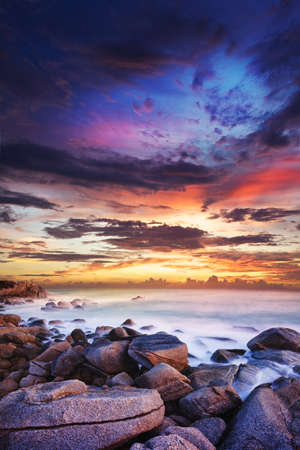 Sunset over the tropical bay. Long exposure vertical shot.