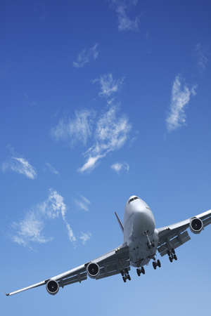 Jet aircraft is maneuvering in a blue sky photo