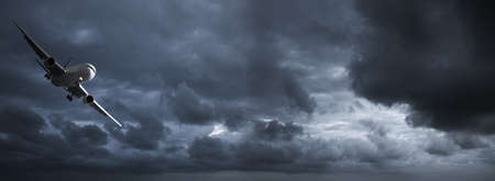 Jet in a dark stormy sky. Panoramic image.