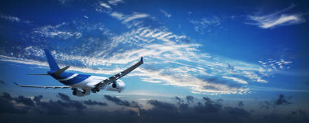airplane take off: Jet aircraft in a sky at dawn. Panoramic composition. Stock Photo