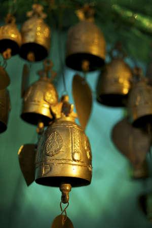 Buddhist bells inside the temple. Vertical shot.