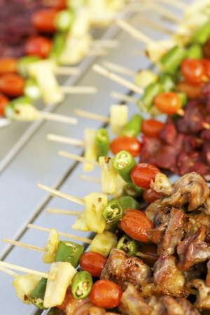 person appetizer: Traditional thai BBQ. Vertical shot, shallow depth of field.