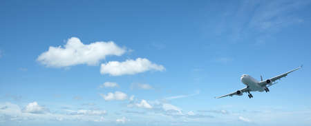 Jet aircraft in a beautiful morning sky. Panoramic composition with a lot of copy space.  photo