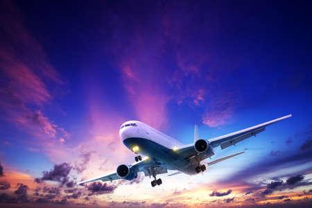 Jet aircraft cruising in a sunset sky Standard-Bild