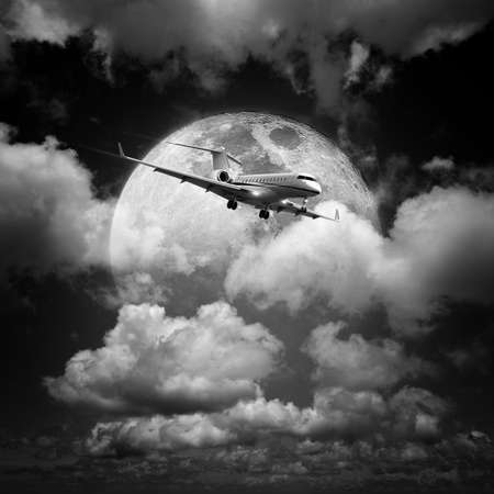 Small private jet aircraft in a night sky. Monochrome, square composition. Stock Photo