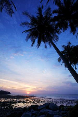 Nai Yang beach at dusk. Phuket island, Thailand. Vertical shot. photo