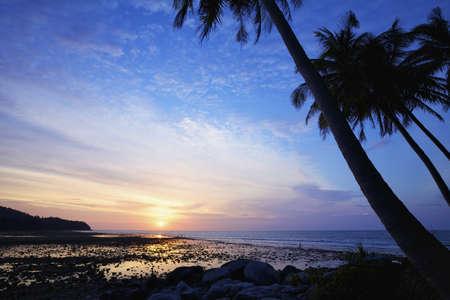 Nai Yang beach at dusk. Phuket island, Thailand. photo
