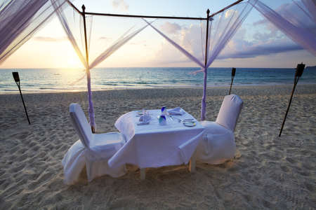 dining table and chairs: A good place for romantic dinner on the beach
