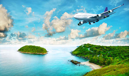 airplane travel: Jet liner over the tropical island. Panoramic composition in very high resolution. HDR processed.