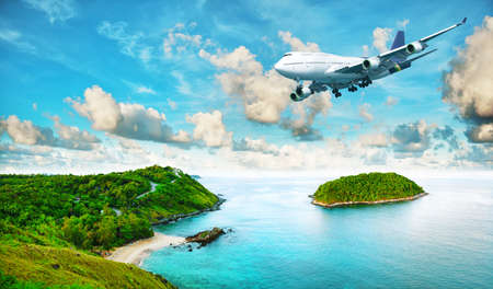 holiday destinations: Jet plane over the tropical island. Panoramic composition in very high resolution. HDR processed.