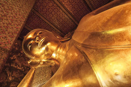 Monument of Reclining Buddha in Wat Pho temple. Bangkok, Thailand. photo