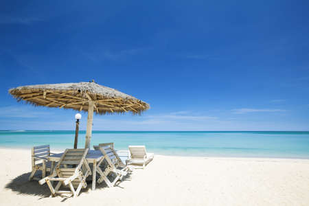White sand beach in sunny day photo