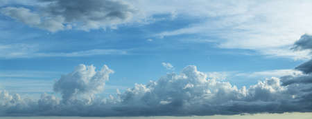 panoramic sky: Blue cloudy sky. Panoramic composition in high resolution. Stock Photo