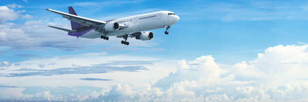 charter: Jet aircraft in flight. Panoramic composition. Stock Photo