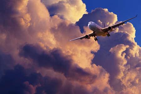 maneuvering: Jet plane is maneuvering for landing in a spectacular sunset sky