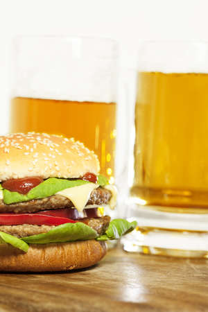 Delicious cheeseburger. Vertical shot. photo