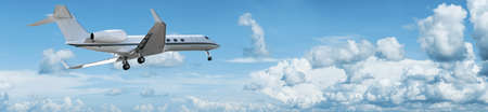 maneuvering: Private jet is maneuvering for landing  Panoramic composition  Stock Photo