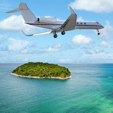 Private jet over the tropical island. Square composition.
