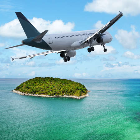 maneuvering: Jet maneuvering over the tropical island. Square composition. Stock Photo
