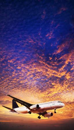 Jet is maneuvering in spectacular sunset sky Standard-Bild
