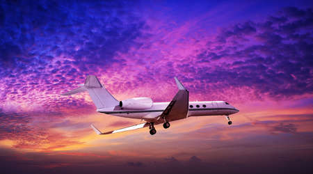 Private jet maneuvering in a spectacular sunset sky photo