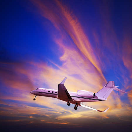 maneuvering: Private jet maneuvering in a spectacular sunset sky. Square composition.
