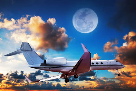 private jet: Luxurious private jet maneuvering in a sky at sunrise time