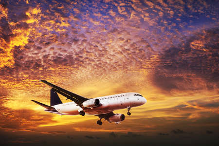maneuvering: Jet is maneuvering in spectacular sunset sky Stock Photo