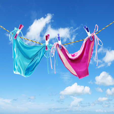 panties: Panties against blue sky. Square composition.